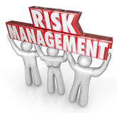 Risk Management People Team Lift Words Limit Liability. Risk Management words lifted by team of people or workers to illustrate a company or oranization's Stock Photography