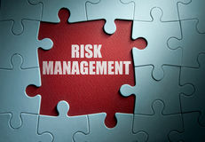 Risk management solution. Missing pieces from a jigsaw puzzle revealing risk management royalty free stock images
