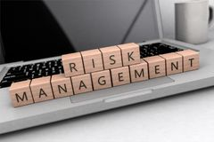 Risk Management text concept. Risk Management - wooden letters on notebook computer - 3d render illustration Royalty Free Stock Photography