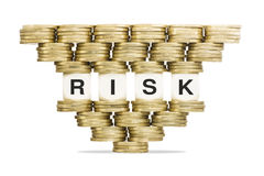 Risk Management Word Risk on Unstable Stack of Gold Coins Stock Photos