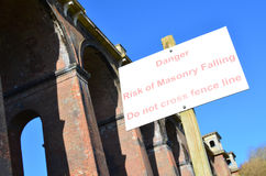 Risk of masonry falling sign. Royalty Free Stock Images