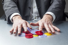 Risk or opportunity for company. Businessman hands playing with casino chips at the office for concept of risk management or taking professional opportunity for Stock Image