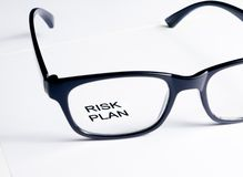 Risk plan words see through glasses lens, business concept Royalty Free Stock Photos