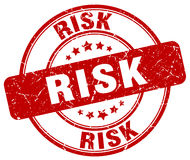 Risk red grunge round vintage  stamp. Risk red grunge round vintage rubber stamp Royalty Free Stock Image
