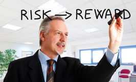 Risk and reward Stock Photo