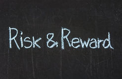 Risk and Reward. On blackboard Royalty Free Stock Photos