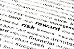 Risk reward keywords. An image of similar keywords focusing on risk and reward with surrounding words in and out of focus Stock Image