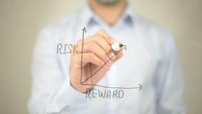 Risk Reward Ratio, Concept Graph, Man writing on transparent screen. High quality royalty free stock images