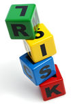 RISK spelled with stacked alphabet building blocks Royalty Free Stock Photos