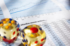 Risk on stock exchange. Two dices on stock data sheet for a concept of risk on stock exchange stock image