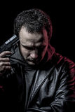Risk, thief, armed man with black leather jacket, dangerous Royalty Free Stock Images