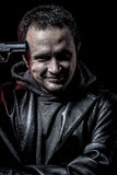 Risk, thief, armed man with black leather jacket, dangerous Stock Photography