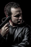 Risk, thief, armed man with black leather jacket, dangerous Royalty Free Stock Photography