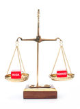 Risk versus reward. Risk and reward dice on weighing scales Stock Photos
