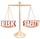 Risk Vs Safety Words Balance Scale Comparing Danger Options Royalty Free Stock Photography
