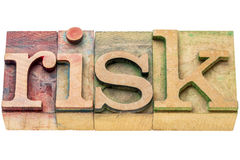 Risk word abstrtact in wood type Stock Photography