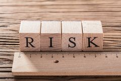 Risk Concept With Wooden Ruler stock images