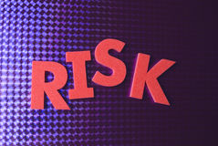Risk word on blue neon background Stock Photos