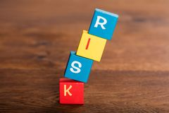 Risk Word On Falling Cubes. Close-up Of Risk Word On Stack Of Falling Cubes Royalty Free Stock Image