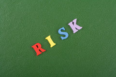 RISK word on green background composed from colorful abc alphabet block wooden letters, copy space for ad text. Learning. English concept royalty free stock photo