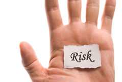 Risk word in hand Stock Photography