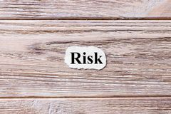Risk of the word on paper. concept. Words of Risk on a wooden background stock photos