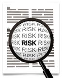 Risk word under magnifying glass. Hand lens Stock Image