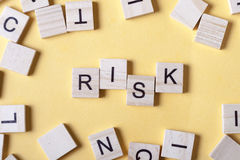 Risk word at wooden blocks on table. Top view Stock Image
