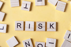 Risk word at wooden blocks on table. Top view Stock Photography