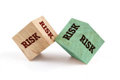 Risk word written on cube shape. Risk word written on cube shape wooden surface isolated on white background Royalty Free Stock Images