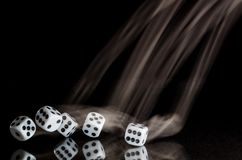 Risking All on a Roll of the Dice. Risking It All on a Roll of the Dice Stock Image