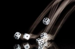 Risking All on a Roll of the Dice. Risking All on a Lucky Roll of the Dice Royalty Free Stock Images