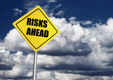 Risks ahead sign. Over cloudy sky Royalty Free Stock Photography