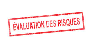 Risks assessment in French translation in red rectangular stamp Stock Photo