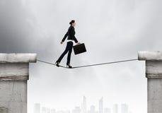 Risky businesswoman Stock Photography
