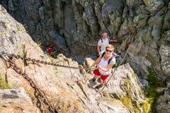 Risky climbing Stock Image