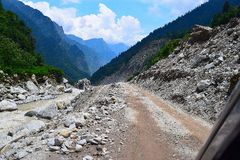 The risky Jshimath-Badrinath highway, Uttarakhand, India. Joshimath-Badrinath highway in Uttarakhand is part of National Highway 58, but it becomes very risky to Royalty Free Stock Image