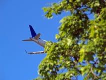 Risky landing II. Aeroplane landing behind the trees, Helsinki Stock Photo