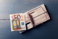 Risky money - euro bill in mouse trap. Top view Stock Photography