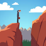 Risky obstacle on a stock market. Businessman standing at the edge of mountain gap he need to traverse to get on top of the mountain. Risky obstacle on a stock Royalty Free Stock Photo