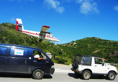 Risky plane landing at St Barts airport. ST. BARTS, FRENCH WEST INDIES - JANUARY 15: Risky plane landing at St Barts airport on January 15, 2004. At 2133 ft its Stock Photography