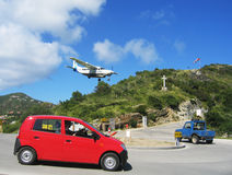 Risky plane landing at St Barts airport Stock Photos