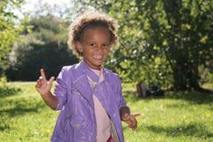 Riso africano bonito da menina Fotografia de Stock