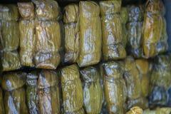 Riso appiccicoso coperto in foglia della banana Fotografia Stock