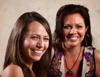 Riso bonito de duas mulheres Foto de Stock Royalty Free