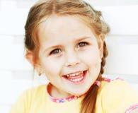 Riso bonito do miúdo Fotografia de Stock