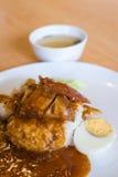 Riso croccante della carne di maiale con l'uovo sodo Fotografia Stock