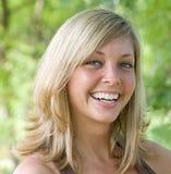 Riso da jovem mulher fotografia de stock