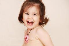 Riso da menina da criança fotos de stock royalty free