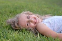 Riso da menina das crianças Fotos de Stock Royalty Free